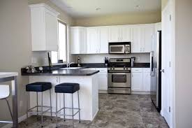 interior tile laminate floors in kitchen with black marble