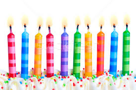 Stock photo Ten birthday cake candles against a white background