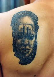 African Tattoo On Back Shoulder