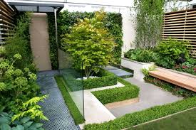 fascinating small gardens design with green wall plant and wooden