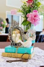 Vintage Themed Centerpiece With Books And Framed Photo Of The Couple Wedding