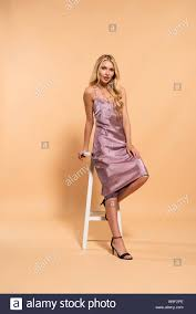 Beautiful Blonde Woman In Violet Satin Dress Posing Near ... Young Woman Leaning On High Chair By Table With Glass Of Baby Shopping Cart Cover 2in1 Large Beautiful Woman Sitting On A High Chair In The Studio Fashion How To Plan Wonder Themed 1st Birthday Party First Elegant Young Against Red Stock Photo Artzzz Fenteer Nursing Cushion Women Kids Carthigh Business Sitting Edit Now Over Shoulder View Of Otographing Baby Daughter Stock Photo Metalliform 2104 Polyprop Classroom 121