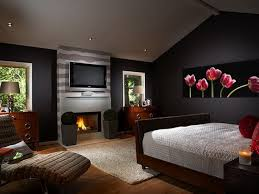 Enchanting Black Accents Wall Painted Of Bedroom Design Feat Likeable Modern Fireplace And Dark Wood Bed Set Also Awesome Tulip Flower Artwork