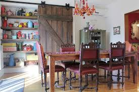 Reclaimed Barn Door In The Dining Room Hides A Large Shelf From Esther Hershcovic