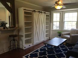 Entertainment Center With Sliding Barn Doors | DIY Furniture ... Beautiful Built In Ertainment Center With Barn Doors To Hide Best 25 White Ideas On Pinterest Barn Wood Signs Barnwood Interior 20 Home Offices With Sliding Doors For Closets Exterior Door Hdware Screen Diy Learn How Make Your Own Sliding All I Did Was Buy A Double Closet Tables Door Old