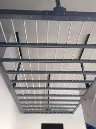 Ceiling Material For Garage by Overhead Storage Racks Huntsville Madison Garage Flooring