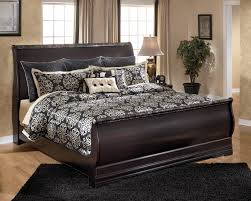 signature design by ashley esmarelda king sleigh bed with faux
