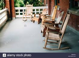 5 Rocking Chairs Empty Sitting On Porch Stock Photo ... Rocking Chair For Nturing And The Nursery Gary Weeks Coral Coast Norwood Inoutdoor Horizontal Slat Back Product Review Video Fort Lauderdale Airport Has Rocking Chairs To Sit Watch Young Man Sitting On Chair Using Laptop Stock Photo Tips Choosing A Glider Or Lumat Bago Chairs With Inlay Antesala Round Elderly In By Window Reading D2400_140 Art 115 Journals Sad Senior Woman Glasses Vintage Childs Sugar Barrel Album Imgur Gaia Serena Oat Amazoncom Stool Comfortable Cushion