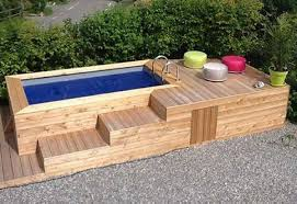 This Is A Whole Big Set Up Created With The Wooden Pallets Seems Like Recreational Place In Garden Of Some Huge House Deck