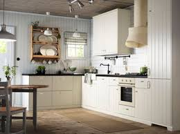 An Off White Country Kitchen With Black Worktops Combined Oven