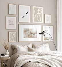 trendy gallery wall beige white bedroom interior beige