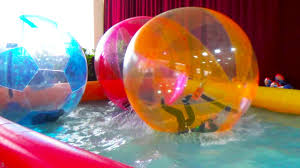 Inflatable Tubes For Toddlers by Giant Water Balls In A Pool Pool Balls Fun Activities For Kids