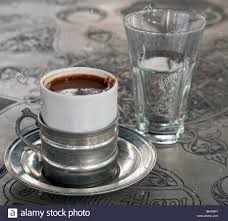 A Cup Of Traditional Turkish Coffee And Accompanying Glass Water