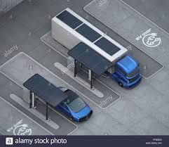 100 Car Truck Hybrid Electric Truck And White Electric Car In Charging Station
