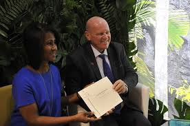 Alain St Ange And The Island Nations Tourism Board Director For Europe Bernadette Willemin Pictured With Luxury Travel Guide Certificate Awarding