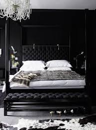 a glorious black bedroom with a calf skin rug and a gorgeous