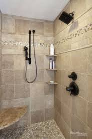 travertine tile shower with java pebble tile floor and glass