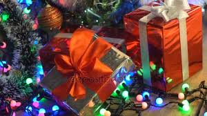 Christmas Gifts Under The Tree Close Up Camera Motion Glittering Lights Background Bokeh