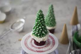 Christmas Tree Cupcakes Dusted With Powdered Sugar To Mimic Snow