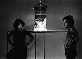 A Couple Viewing The Head Of Italian Criminologist Cesare Lombroso Preserved In Jar Formalin At An Exhibition Bologna 1978