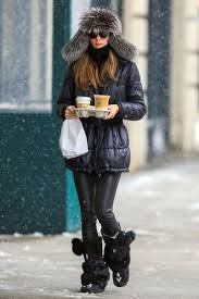 Black Snow Boots With Gold Buckles Olivia Palermo Puffer Jacket Leather Leggings And Fur Pom