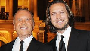 Designer Michael Kors marries longtime partner CBS News