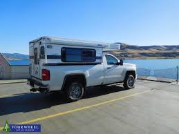 Vanlife In A Pick-up Truck Camper Near The Beautiful Lake On A Sunny ... This Popup Camper Transforms Any Truck Into A Tiny Mobile Home In Our Twoyear Journey Choosing Lifewetravel 1996 Shadow Cruiser 7 Slide Pop Up Truck Camper Youtube Amazoncom New 164 Hitch Tow Series 8 Green 2015 Ford F150 Streamlined Pickup Features Lweight Composite Design Colorful Phoenix Campers Carbon Fiber Popup Might Be Lightest Out There Wedge Assorted Oddities Tacoma World The Lweight Ptop Revolution Gearjunkie Used Blowout Sale Dont Wait Bullyan Rvs Blog Solid Wall Versus Alaskan