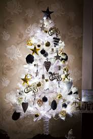 Like Mentioned Earlier Decorating A White Christmas Tree Can Be Easy Any Bright And Vibrant Colors Would Stand Out Against It In This Small