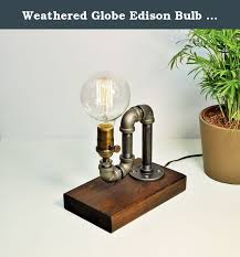 weathered globe edison bulb industrial steunk rustic pipe table