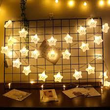 weihnachtsstern lichterkette mit smiley gesichtsausdruck