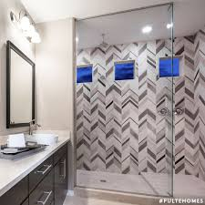 Mixing Tile Patterns Adds Modern Drama To This Glam Master Bathroom