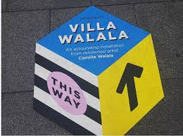 Close Up Of Sign For Villa Walala In Broadgate City London