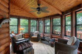 Rustic Sunroom With Wicker Furniture Ceiling Fan Wood