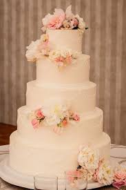 classic 5 tiered buttercream confection by Confectionery Designs · Wedding Cakes