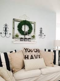 Create A Lovely Rustic Living Room Wall Display Using Antique Accents Vintage Wreath And Distressed White Shelf