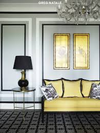 Chic Black Yellow Living Room Design With Gray Walls Brass Accent Table Geometric Rug Settee Silk Pillows White Toile