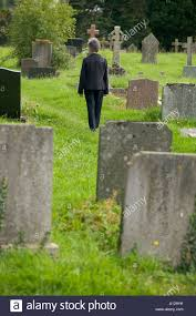Woman Walking Through Cemetery