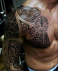 Upper Chest And Half Sleeve Tribal Tattoos For Guys