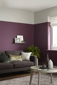 Grey And Purple Living Room Paint by Addiction Purple Sharply Contrasted Against Grey Putty To Create