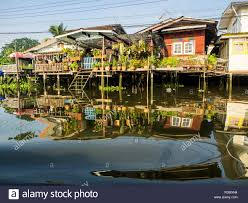 100 Homes In Bangkok Thailand In Reflection Along Back Canal