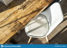 Rustic Dining Table With White Faux Leather Chair Stock ...