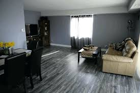 Dark Grey Laminate Flooring Living Room Cream Leather Sofa Black Dining Table Wall Painting