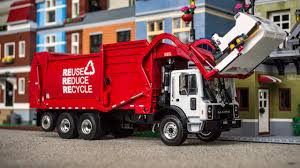 First Gear Mack TerraPro Heil Freedom Front Load Garbage Truck - YouTube