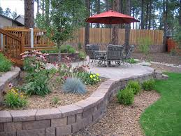 Prepossessing Low Maintenance Landscaping Ideas For Of House ... Deck Patio Maryland Exterior Stone Half Wall With Iron Chairs And Round Table Plus Ideas Diy For A Sloped Backyard Home Garden Decor Wonderful Landscaping Sloping Front Yard Pictures Design Enclosed On Budget Need Please Steep Slope Inside Backyards Innovative Best About Picture How To Landscape A Diy Raised Patio With Steps Down Second Space Two Level Amazing Plan That You Should Consider