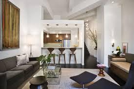 Small Apartment Interior Design Ideas White Cushions Brown Curtains Cream Carpet Flooring Square Glasstop Table