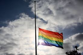 A Pride Flag Stands Half Mast During Memorial Service In San Diego California