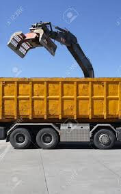 100 Demolition Truck Claw Dumping Material Into A Waiting Stock Photo
