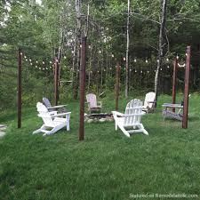 Remodelaholic Easy Diy Outdoor Lighting Around A Fire Pit String Posts And Seating Area Featured On