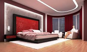 Modern Wall Sconces Fixtures Between Red Floral Headboard And Low Profile Bed On White Fur Rug Also Fabric Cover Accent Chair