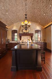 sloped ceiling lighting kitchen mediterranean with eat in kitchen